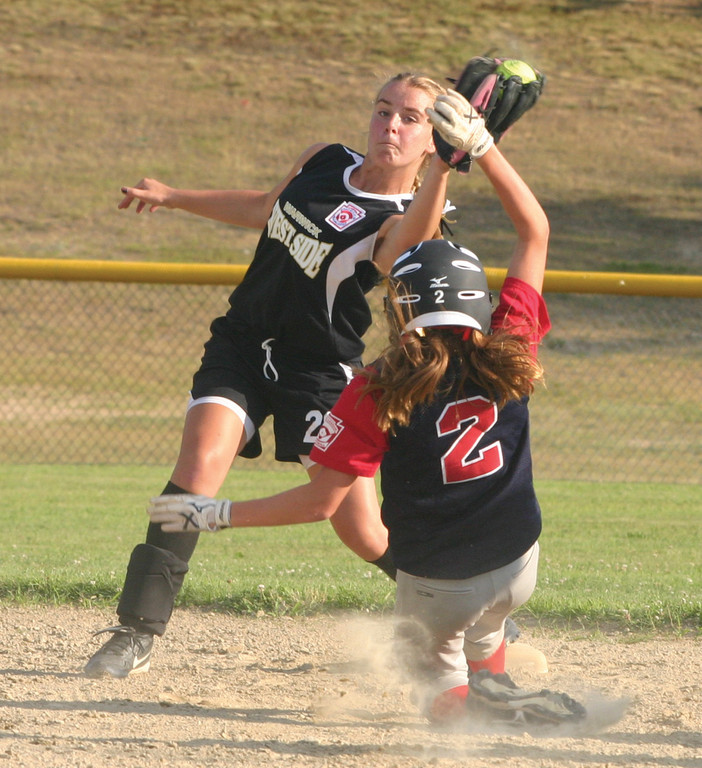 CLOSE CALL: Jeriann Evans catches the ball at second base while Emma Campbell slides in safely.