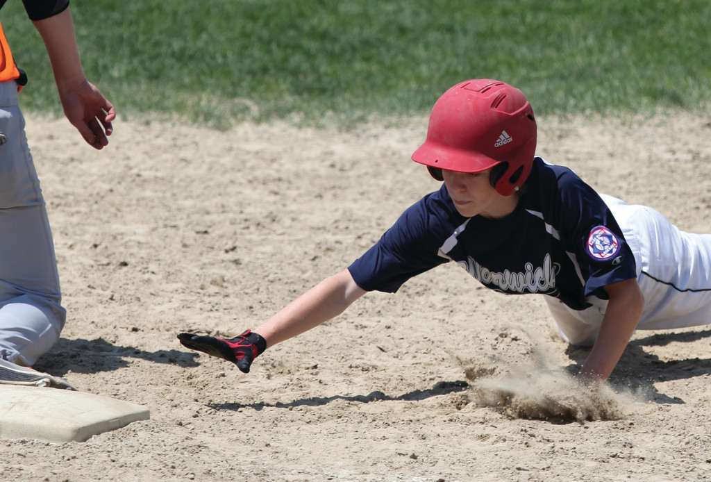 REACHING OUT: Avery Ingegneri dives back to first base on a pick-off attempt.