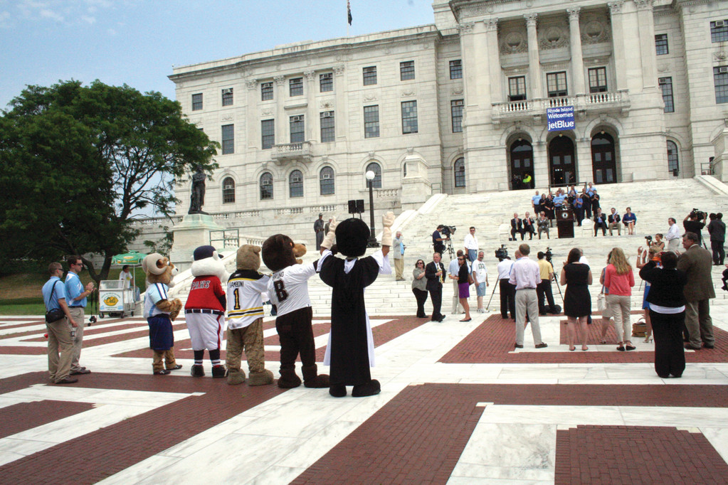 WAVE FROM THE MASCOTS: Rhode Island team mascots wave to officials on the steps of the State House during yesterday's announcement that JetBlue will be coming to Green Airport this fall.