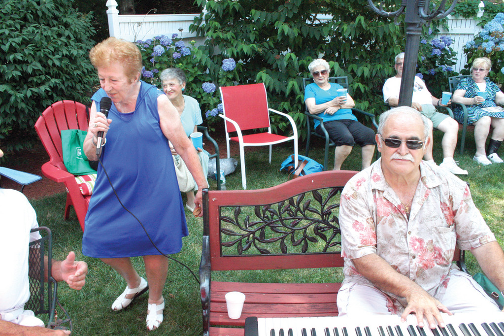 NO DANCING, PLEASE: With Tony Pisano on the keyboard, Diane Carley sings favorites for the gathering.
