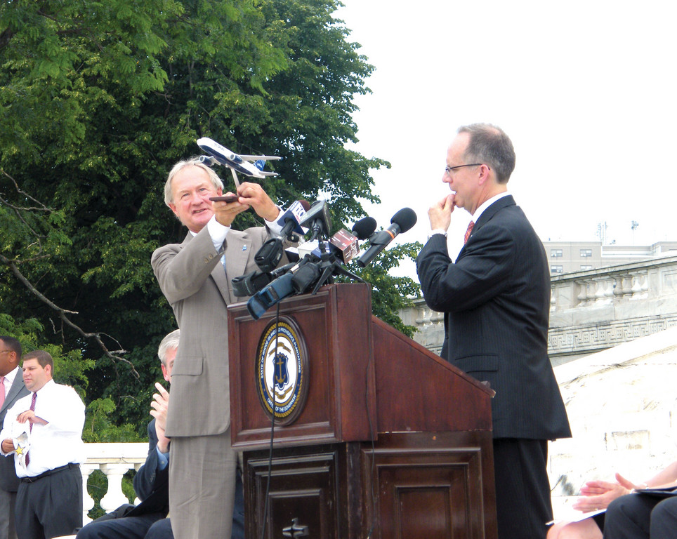 LIFT OFF: Governor Lincoln Chafee takes a model plane into the air as Dave Barger, president and CEO of JetBlue, looks on.