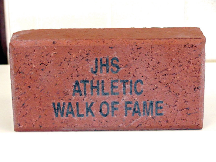 WALK OF FAME: This is a sample brick that Gary Mazzie has on display in his Johnston High School athletic director�s office. All bricks for the Panthers� first-ever Walk of Fame will be produced exclusively by Spaulding Brick of Cranston.