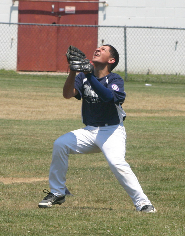 CAMPING OUT: Warwick's Trent Perry waits for a fly ball in the outfield last Saturday.