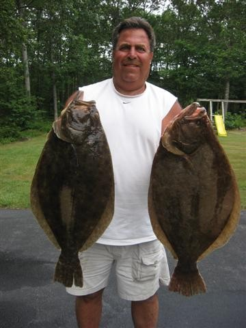 Angler Ed Mardo with two of the doormat fluke he caught this weekend when fishing the south side of Block Island.