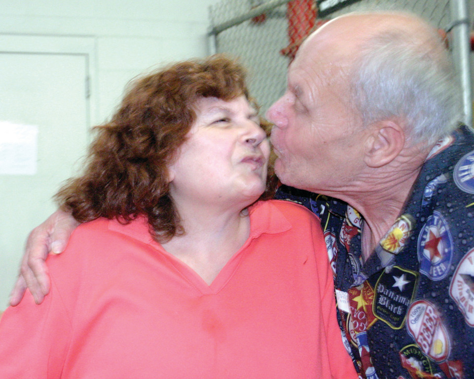 PUCKER UP: Richard Bert Gough and Susette Pastore have been together for nearly four years and recently got engaged. In fact, they met at the Patterson Building. �She�s very nice and she�s very good to me,� said Richard, while Susette said, �He�s handsome, he�s nice to me, and he�s going to marry me.� Further, she�s looking forward to going shopping for her wedding gown. �I want a straight one with a stripe on the bottom,� she said, �and I want to see him in a tuxedo.�