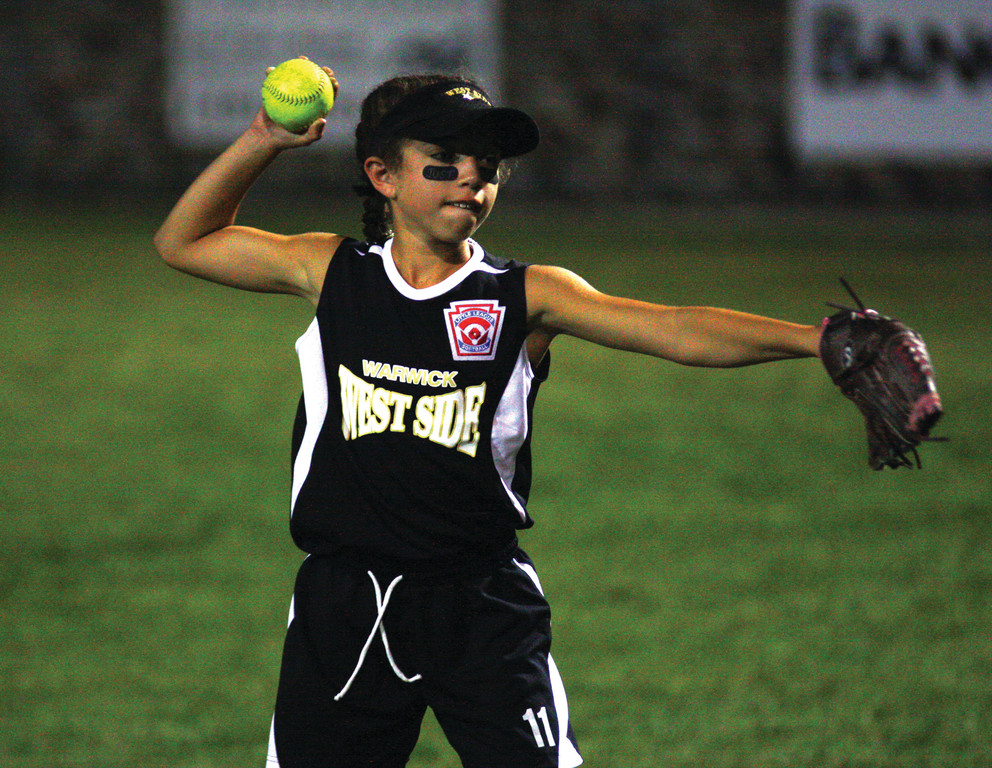 ON THE BALL: Dyonna Rodas gets ready to throw a ball to first base.