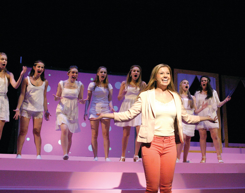 OMG: Lizzie Bateson as Elle Woods sings with her sorority sisters in the background.