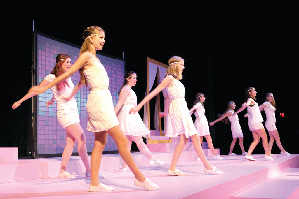 IN STEP: Molly Murphy, at left, and the women of the ensemble bust a move.