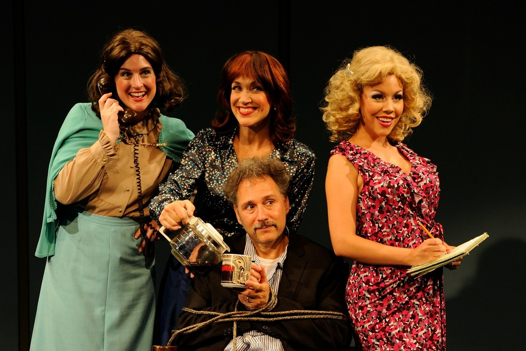 Rhode Island native Kevin Pariseau as Franklin Hart Jr., is surrounded by (from left) Lulu Lloyd, Jan Leigh Herndon and Maggie McDowell as Judy, Violet and Doralee in the Rhode Island premiere of Dolly Parton�s �9 to 5: The Musical� being presented at Theatre-By-the-Sea through Aug. 11. For tickets call 782-TKTS (8587) or visit www.theatrebythesea.com.