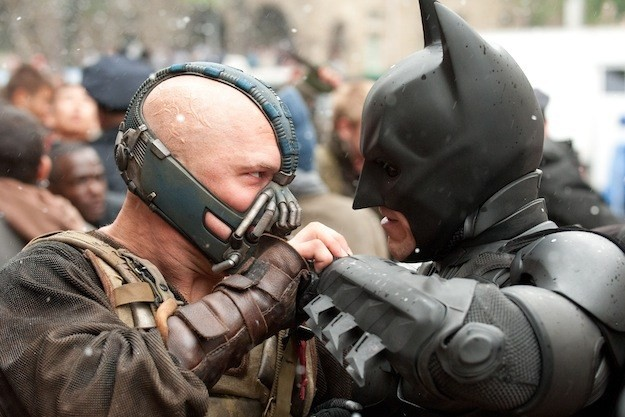 "Bane (Tom Hardy) takes on Batman (Christian Bale) in ""The Dark Knight Rises."""