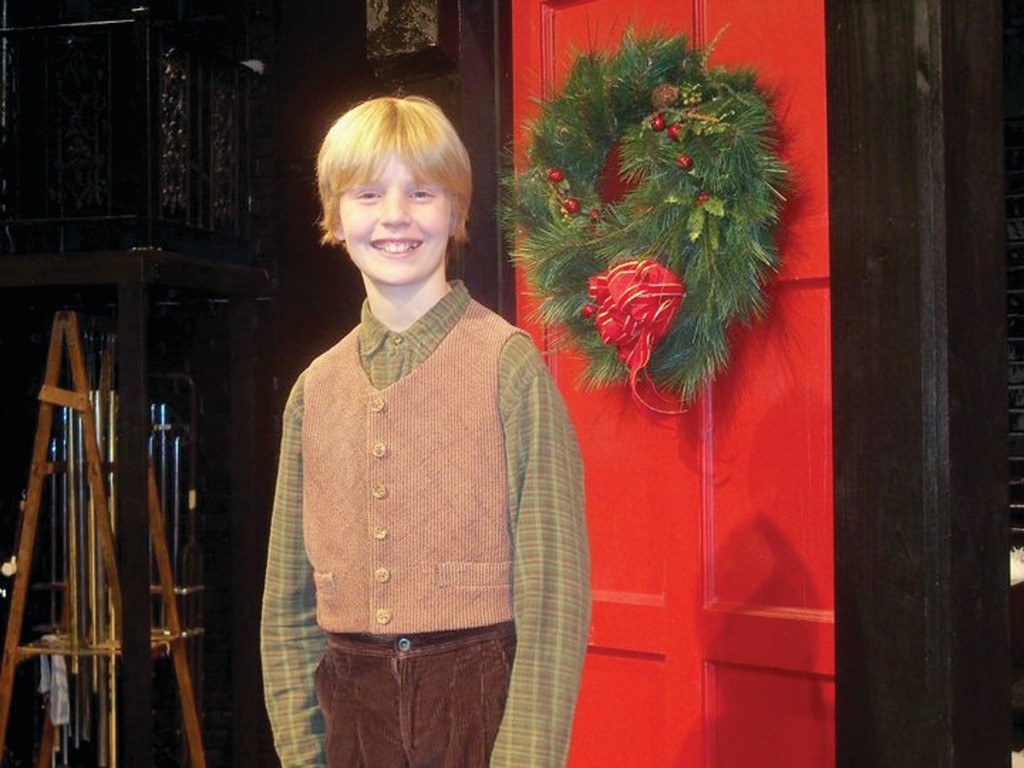 "Roque poses for a picture during his run of ""A Christmas Carol"" at Trinity Rep."