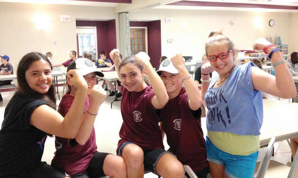 GOING STRONG: Campers show off the muscles they say they developed at Camp Fogarty. From left: Julia French, Brittney Boyd, Natasha Savage, Brianna Boyd and Catherine Brennan.