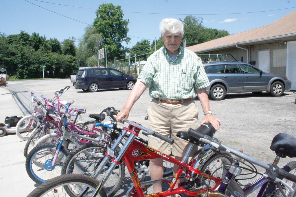 GREAT PRICES: Raymond MacDonald with a portion of the selection of used bicycles he sells from his latest venture located on West Shore Road in Conimicut.