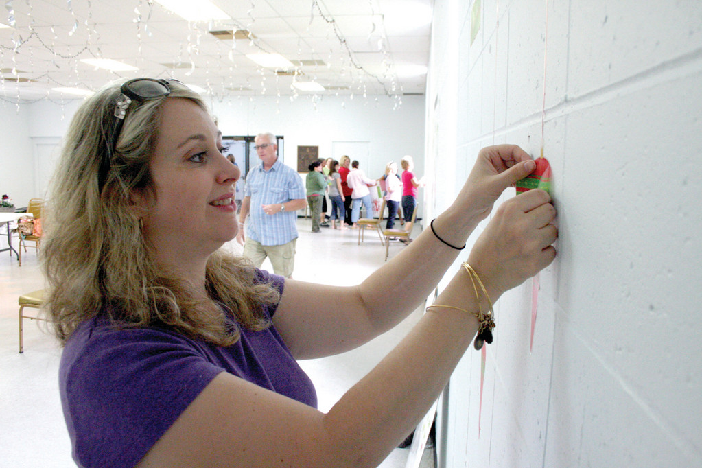 DECKING THE HALLS: Jackie Hammett affixes Christmas decorations at the impossible Dream building.