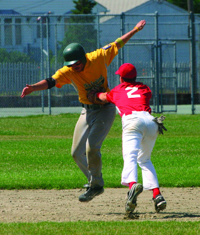 GOING FOR IT: NEFL's Teddy Dwyer tries to escape a tag from Senerchia's Ed Markowski in a game earlier this season. NEFL and Senerchia are two of the top four seeds for the American Legion Playoffs and they begin play today.