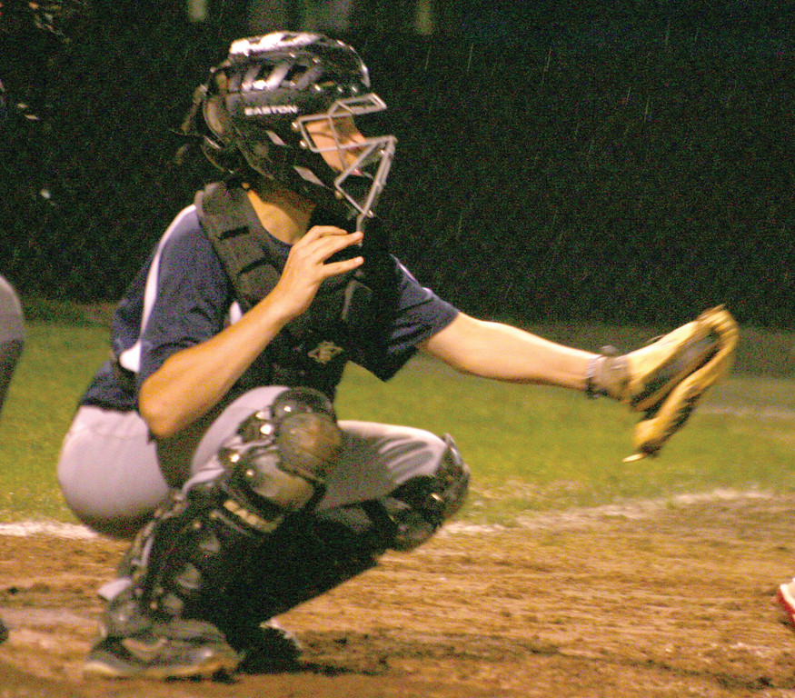 Sean Creamer catches a strike down the middle. PAL was hoping to stay alive in Monday's game.