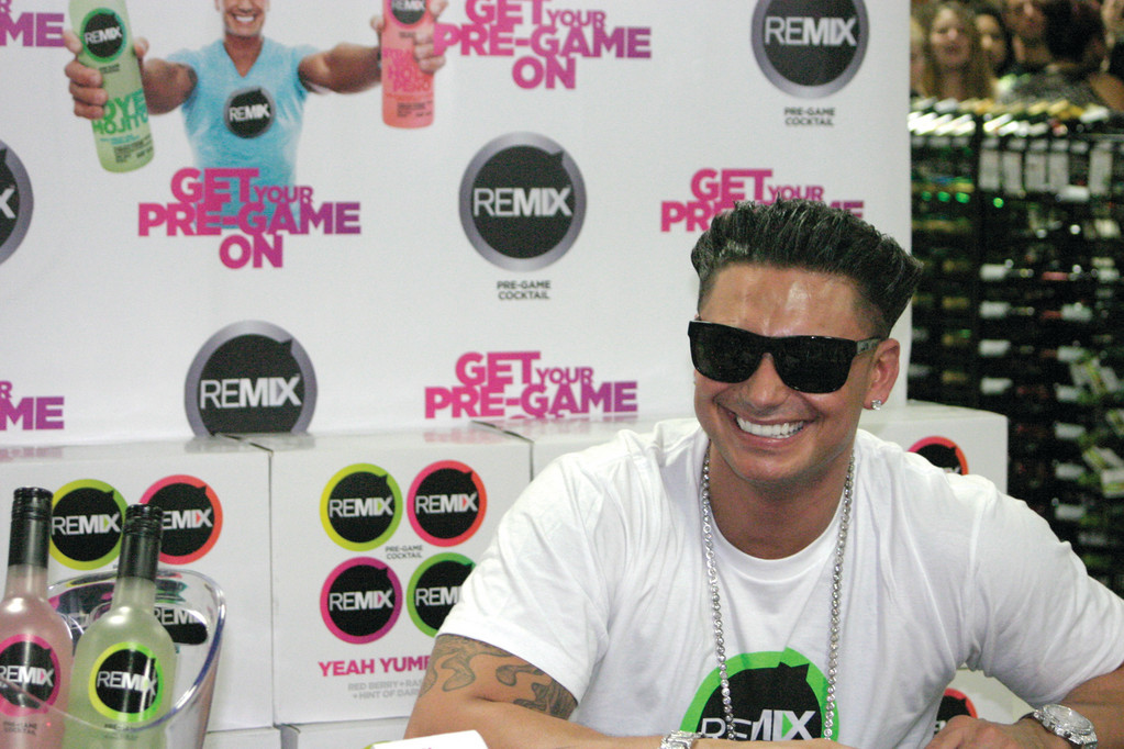 "More than 500 eager fans gathered at Haxton's Toll Gate Liquors on Bald Hill Road in Warwick Monday for a chance to meet Paul ""DJ Pauly D"" DelVecchio, who stars in MTV's ""The Jersey Shore"" and ""The Pauly D Project."" He was in Rhode Island promoting his new ""pre-game"" cocktail, REMIX."