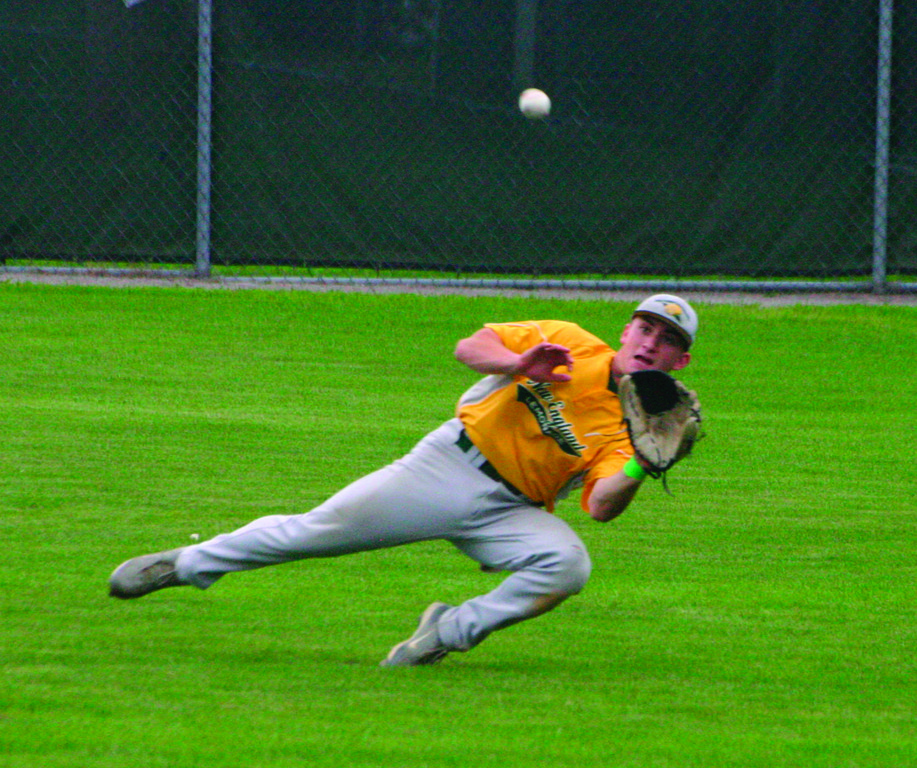 GOING FOR IT: NEFL's T.J. Boyajian tries to make a sliding catch in right field during Tuesday's playoff game.