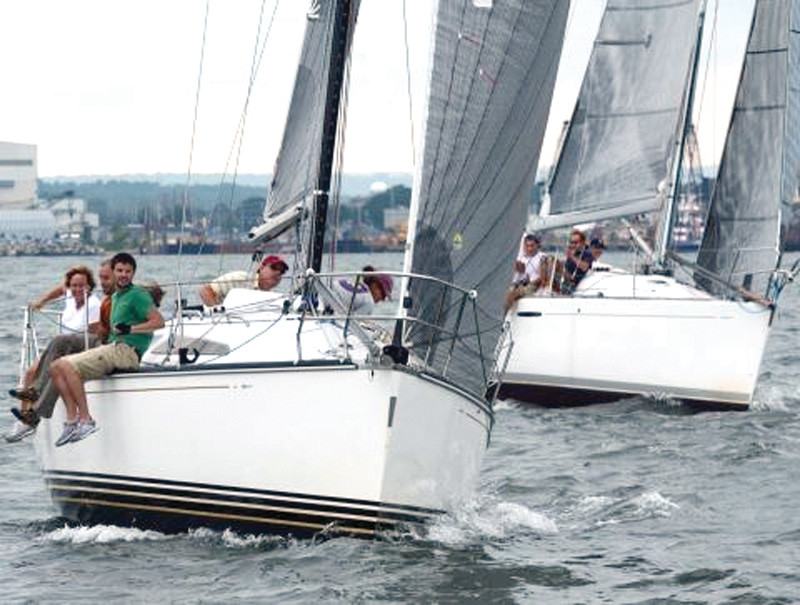 STAYING DRY: Competitors in the East Greenwich Annual Regatta, held last Saturday, escaped the deluge those on land experienced. With light wind conditions, the race committee had more than 60 boats sail a short course.