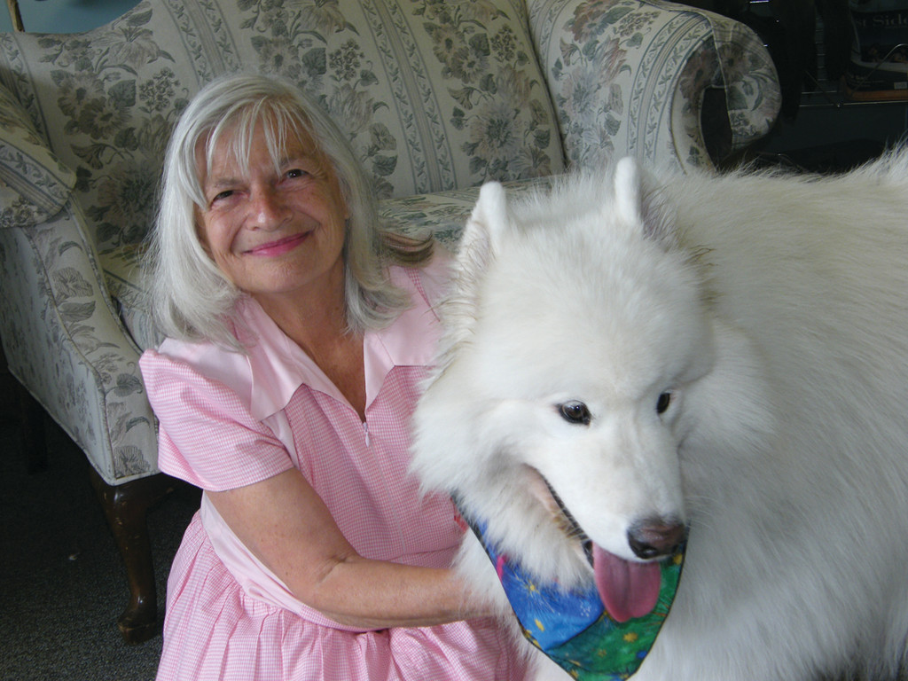 "DOG LOVER: Pearl Salotto, the woman who brainstormed the new animal advocate law, and her pet therapy dog Angel, a.k.a. ""Jelly."""
