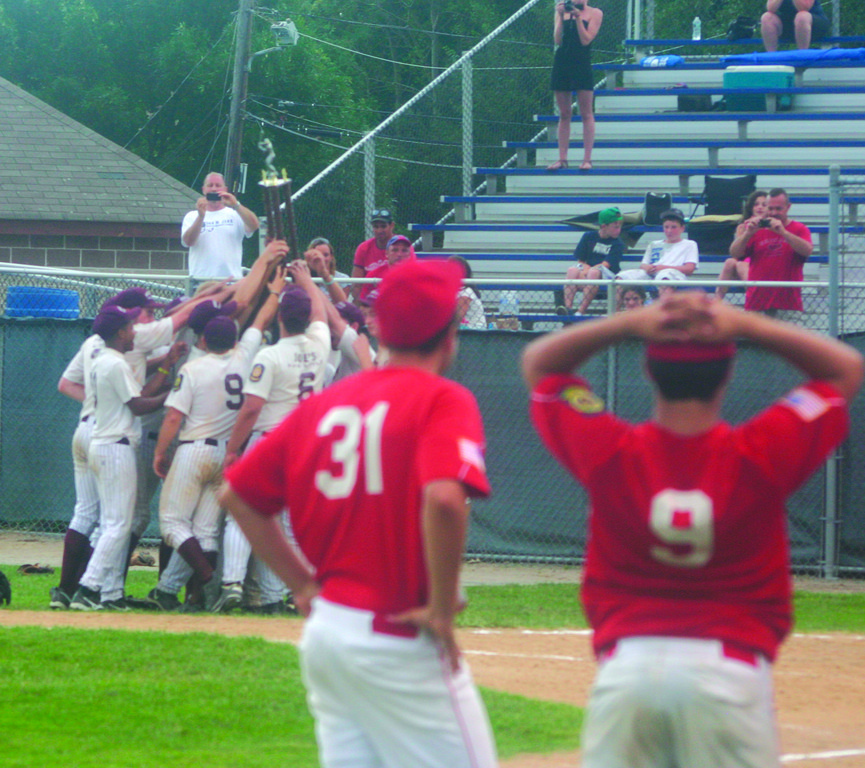 UPSET WATCH: Senerchia players take in the scene after Navigant Credit Union/Woonsocket Post 85 received the American Legion state championship trophy on Sunday. Navigant beat Senerchia twice to claim the prize.