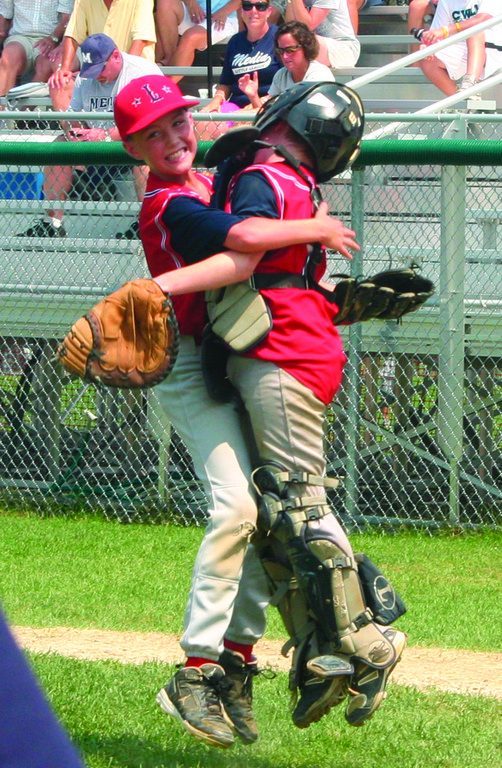 JUMP AROUND: Jackson Murray and Ben Arter celebrate Saturday's Eastern Region championship.