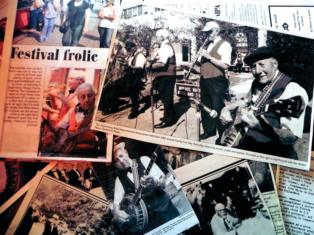 SCRAP BOOK TIME: Guitarist Nat Piccirilli has enough press clippings to fill several scrapbooks, dating back to when he played on the radio as a teenager.
