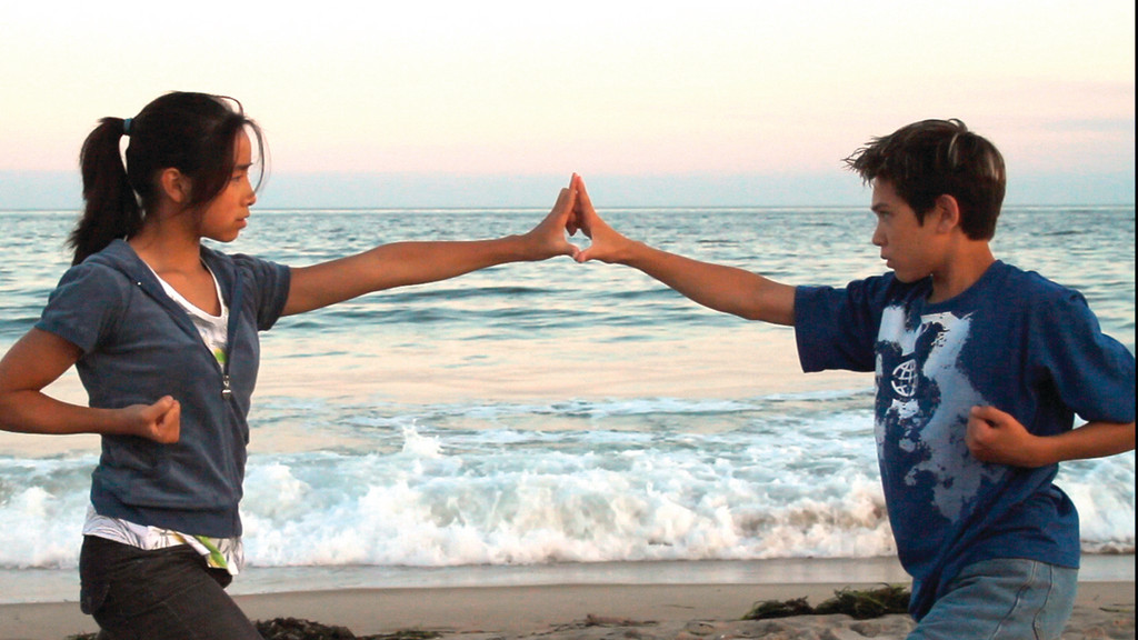 CHAMPIONS OF THE DEEP: World-renowned martial artists Dayna Huor and Tyler Weaver Jr. star in the film and pose in a scene that was filmed at Misquamicut Beach in Westerly.