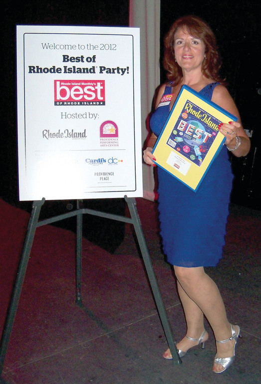 Laurie Langford shows off her Best of Rhode Island award as the best gift shop in the state. The award is determined by an online customer vote, and Langford already has her plaque on display at Wishes Under Wrap on Greenville Avenue.