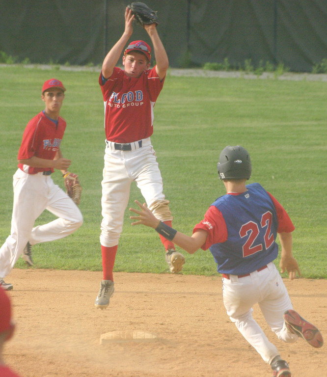 Ryan Rotondo catches a hight throw as Travis Simpson tries to steal second on Tuesday.