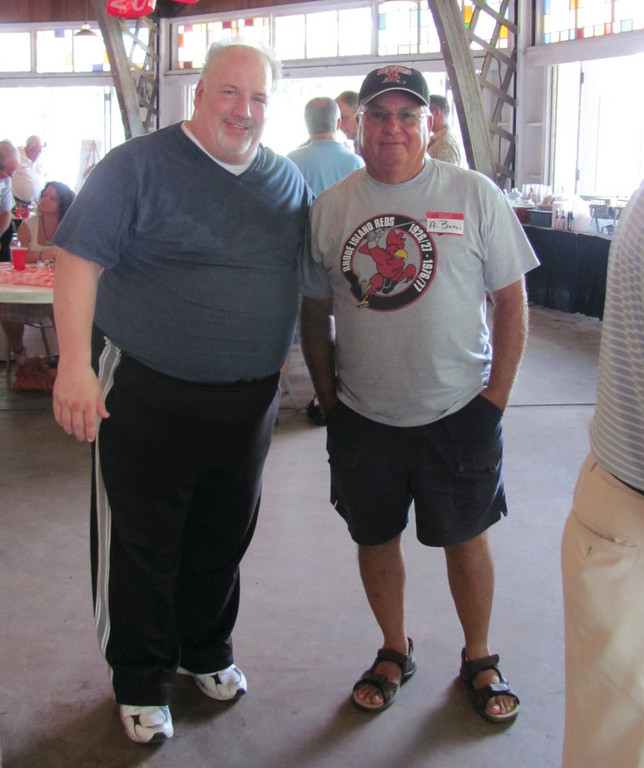 Dave DiLorenzo (left), an experienced sports caster who has broadcast many professional sports events who has also done voice-overs for the NFL films, enjoys a lighter moment with long-time Reds fan Al Bucci at Sunday's Reds Heritage Society Reunion at Goddard Memorial State Park.