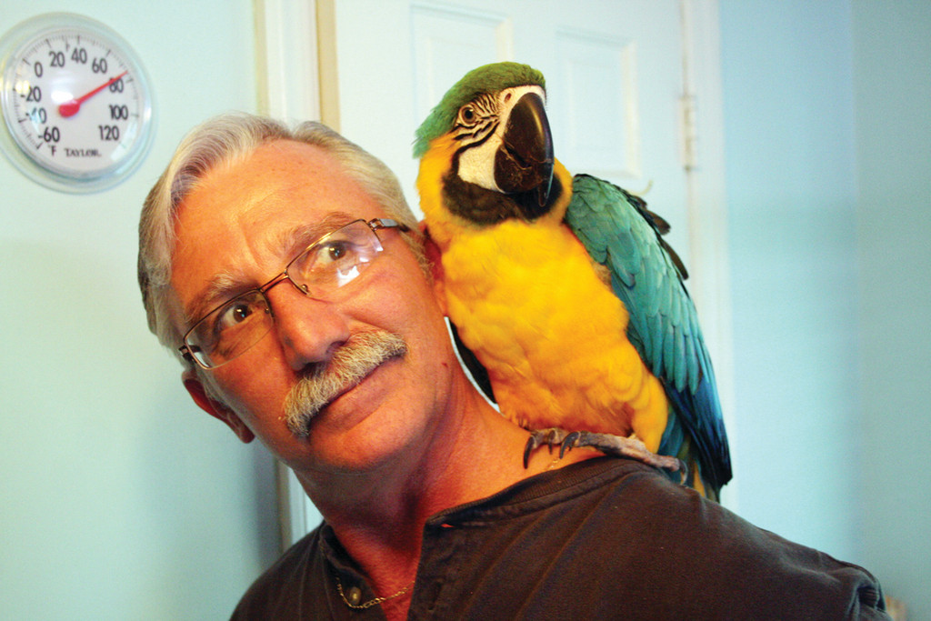 HOME AGAIN: Kevin DeWolf and his feathered friend Sunni.