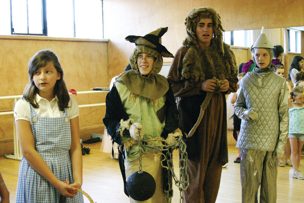 FAMOUS QUARTET: Dorothy, the Scarecrow, Cowardly Lion and Tin Man get ready to head to Oz. They are, from left, Kayley Sullivan, age 13; Nathaniel Savage, 13; Aidan Perry, 16 and  