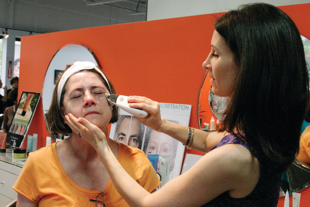 ANTI-AGING PRODUCT: Jennifer DelAngelo, representing the anti-aging product, performs a treatment on Mary Pluta.