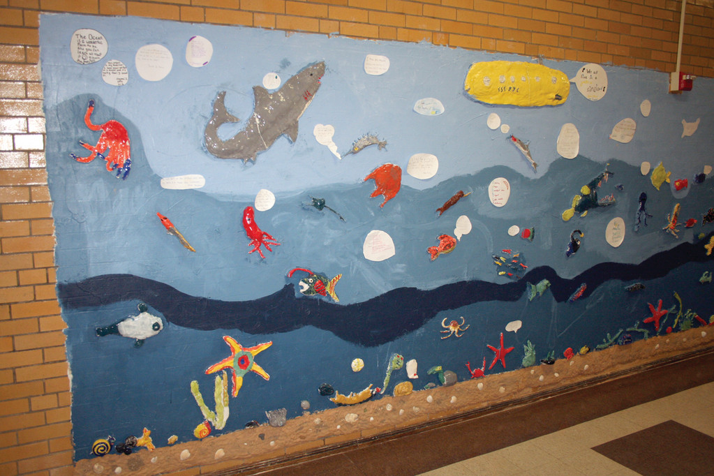 READY FOR UNVEILING: The sea life mural spans an entire wall of the upstairs hallway at Edward S. Rhodes Elementary School and was completed by the students in the intermediate grades, along with the faculty members, parent volunteers and Artists in Residence from the Artists' Exchange.