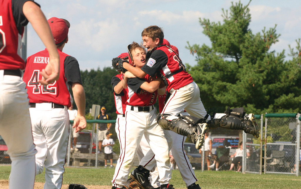 CELEBRATING AGAIN: Fairfield American's Biagio Paoletta and Will Lucas celebrate after winning the 2010 Eastern Region Invitational in Cranston.