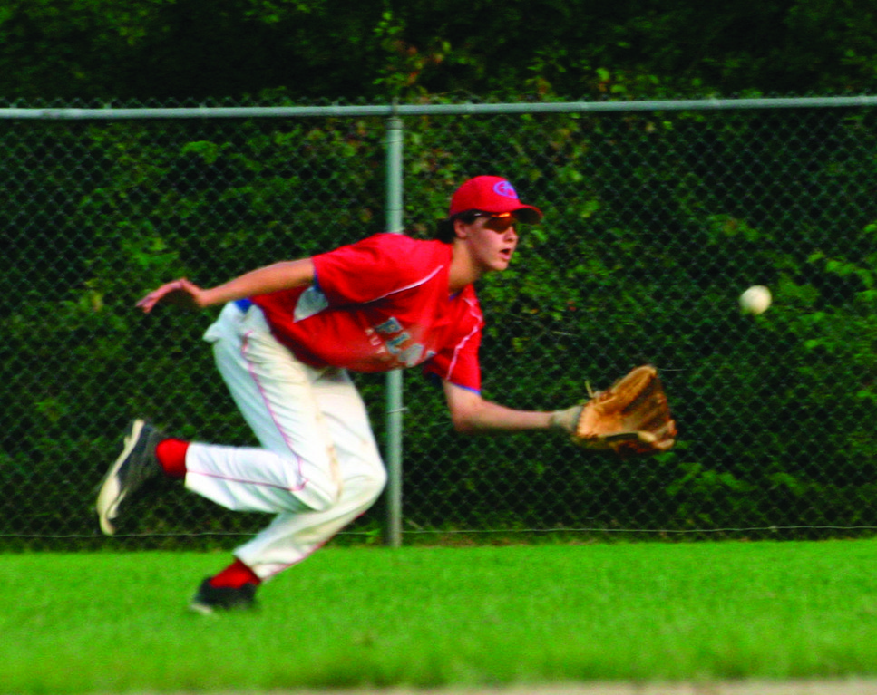 CHARGING HARD: Flood center  fielder Brady Chant makes a running catch of a line drive.