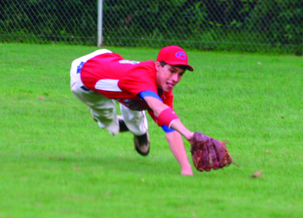 ALL OUT: Flood's Kevin Sutyla dives for a line drive in Tuesday's Connie Mack state championship. Sutyla made the catch, but Cranston held off a charge from Flood to win 2-1.