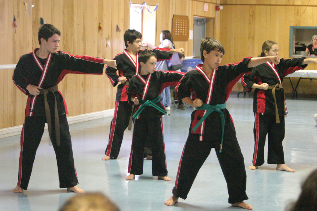 "QUITE THE ""SHO"": Members of the 2012 demo team from ShoDan Karate of West Warwick said they were thrilled to ""sho"" Trudeau their martial arts skills during the event's ""visit"" of Asia. From left are Andrew Ferguson, 11, Jacob Costello, 12, William Ferguson, 8, Jack Smith, 11, and Kaitlyn Iavarone, 12."