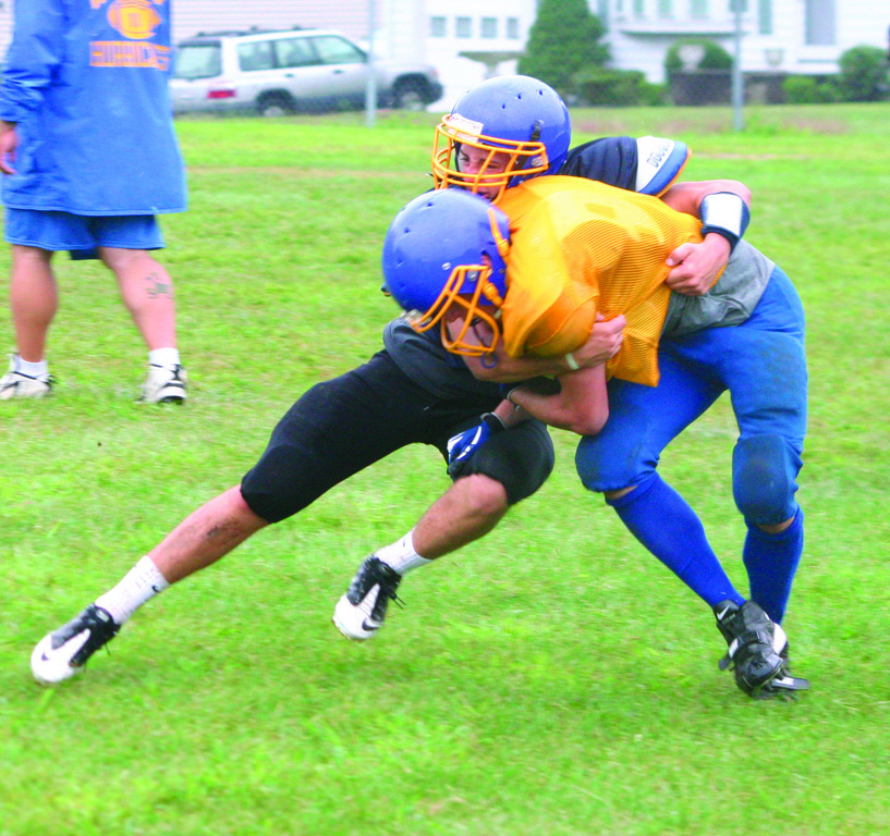 TAKE HIM DOWN: Tony Lonczak makes a tackle during practice.