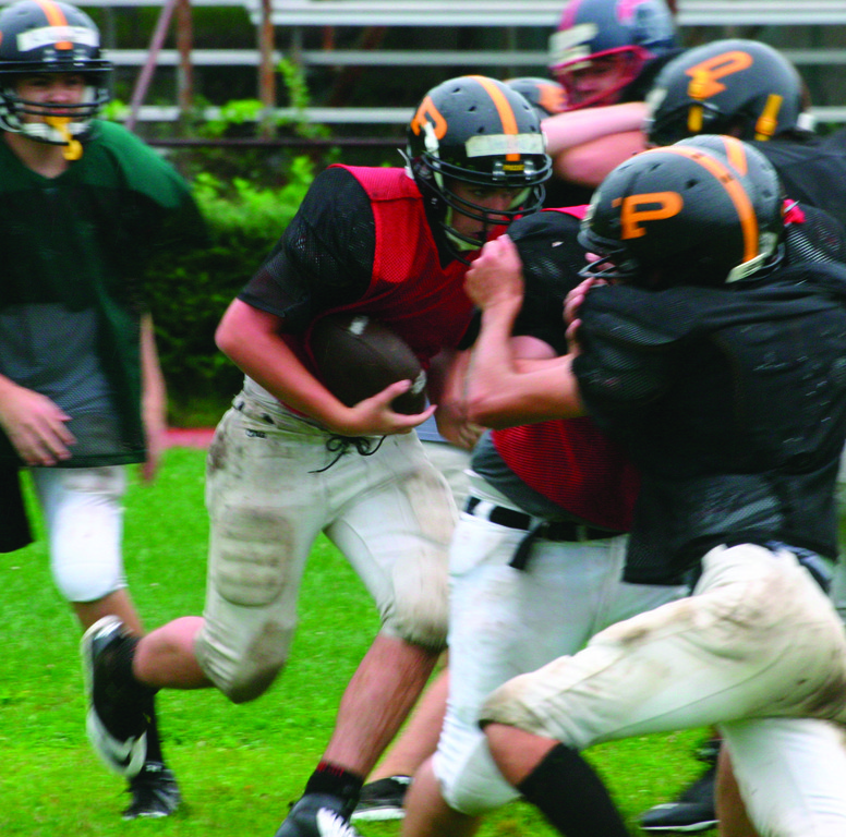 KEY COGS: Luke Verrier runs behind the offensive line.