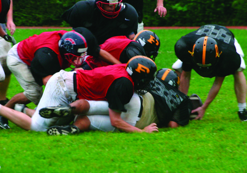 ON THE BALL: Pilgrim players try to dive on a fumble during practice over the weekend.