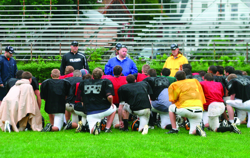 RIGHT DIRECTION: Pilgrim coach Tom O'Connor speaks to his team after practice over the weekend.
