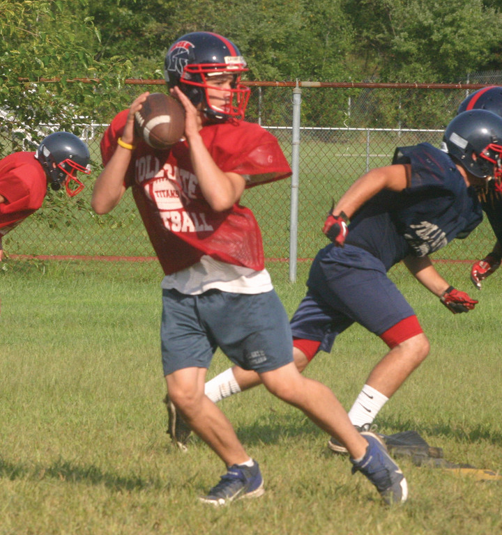 DOWNFIELD: Aaron Travers drops back to pass during practice last week. Travers, a junior, is penciled in as the starting quarterback for the Titans.