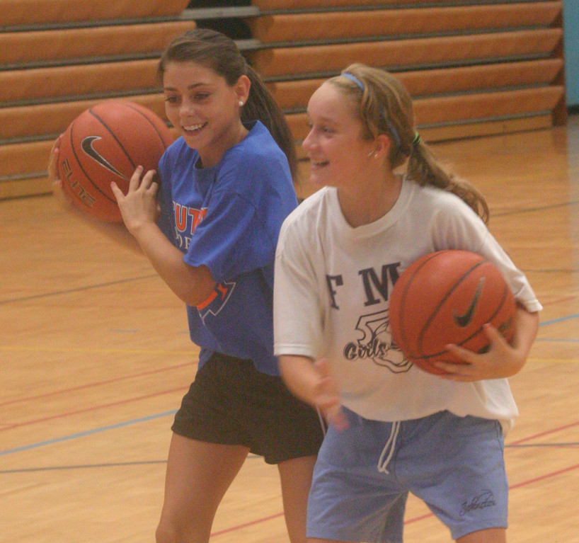 ALL SMILES: Ciana Gaudiana and Samantha Hardman have a little bit of fun on the court.