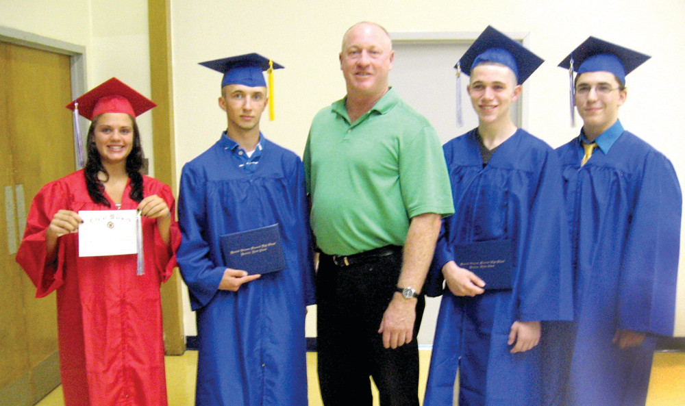 LAST, BUT NOT LEAST: In a brief ceremony that was held at Warwick Veterans Memorial High School yesterday, students received diplomas after completing summer school. Principal Gerry Habershaw led the commencement for graduates Danielle Pietros, (left) Kevin Hickey, Kyle Rigby and Dylan Grant.