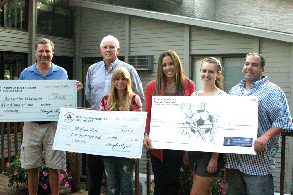 SOCCER STARS: To celebrate soccer players interested in earning a higher education, the Warwick Fire Fighter Soccer Club teamed up with Michael and Holly Zuller of the Elanna L. Zuller Memorial Sports Fund to give four local high school students $500 college scholarships. Winners included Meghan Hart (front, center) Amanda Ruggieri (second from right), as well as Alessandra Widmann and Brent Parker, who are not shown. Widmann's father, Dave (left), who stands next to Doyle Byrd, president of the WFFSC, accepted the award for his daughter, while the Zullers help Ruggieri hold her check.