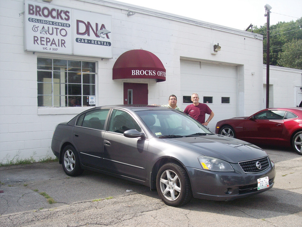 Longtime customer Fred DeMaio and owner Anthony Broccoli showcase Fred's 2005 Altima – the product of Brock's expert workmanship and service.