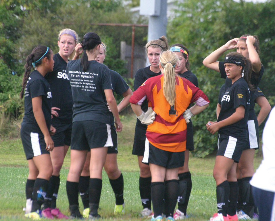 HUDDLE UP: Members from the Pilgrim girls' soccer team gather together during a game on Saturday at Warwick Vets.