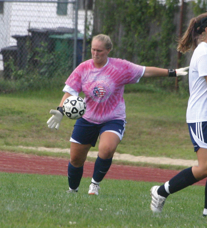 FOCUSED: Meghan McNulty punts the ball out of Toll Gate's end.